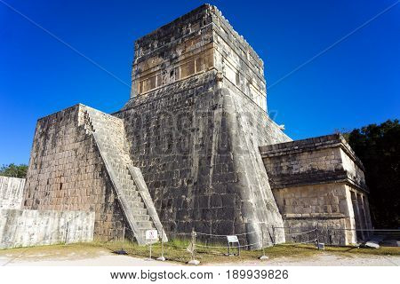 Temple in the ruins of Chichen Itza in Mexico next to the great ball court