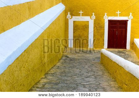 Ramp going down a yellow and white monastery in the town of Izamal Mexico
