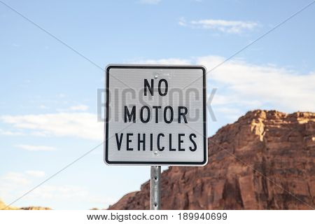 A black and white No Motor Vehicles sign