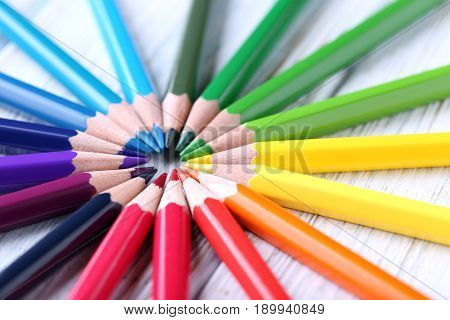 Colorful pencils on the white wooden table