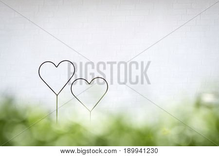 Two hearts together in a bright future with green colors in decoratiive shapes in the spring
