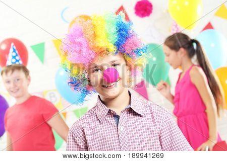 Happy clown boy having fun at birthday party