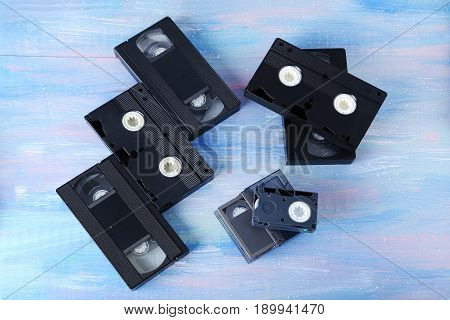 Video cassette tapes on the wooden table