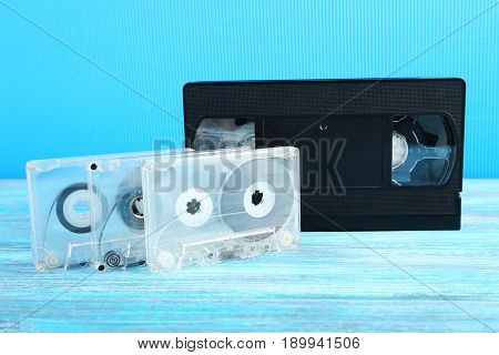 Video And Music Cassette Tapes On Wooden Table
