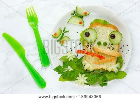 Frog sandwich - creative idea for kids lunch fun animal sandwich shaped frog with bread and vegetables