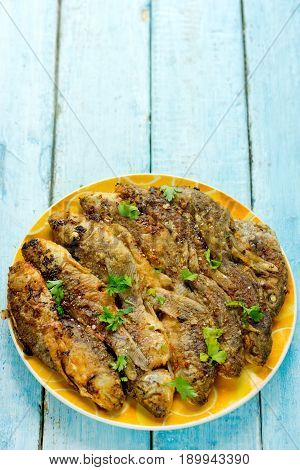Fried fish with golden crisp skin on plate