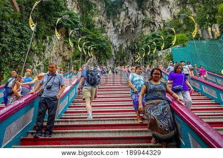 Kuala Lumpur, Malaysia - March 9, 2017: entrance steps to Batu Caves, a limestone hill with big and small caves and cave temples and a very popular Hindu shrine outside India
