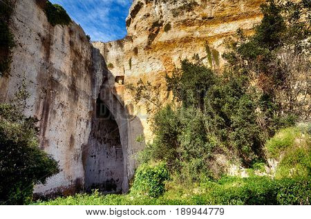 The entrance to the cavern known as the Orecchio di Dionisio (Ear of Dionysius) in the Archaeological Park in Syracuse, Sicily, Italy