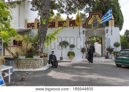 PALEOKASTRITSA, GREECE - MAY 15: Monk before entering the Monastery of of Virgin Mary on May 15, 2017 in Paleokastritsa, Corfu island in Greece.
