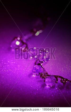 Elegant jewelry  with gemstones in night neon light