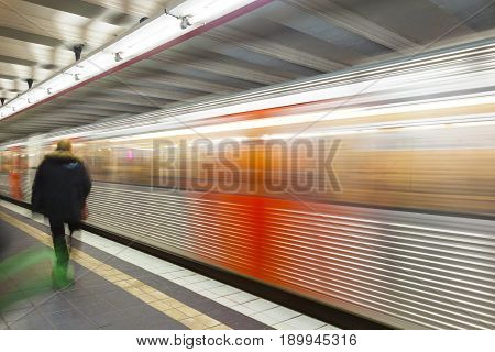 train with speed in motion and blurred passenger