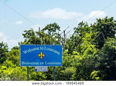 welcome to louisiana sign at the highway