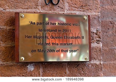 June 6th, 2017, Cork, Ireland - English Market, a municipal food market in the centre of Cork, famous tourist attraction of the city: commemorative plaque to remmeber Queen Elizabeth II's visit.