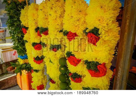 Close up shot of beautiful and colorful hanging flower garlands
