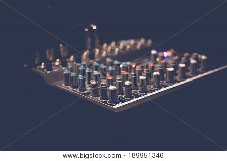 Music sound mixer console. Sound system equalizer buttons.