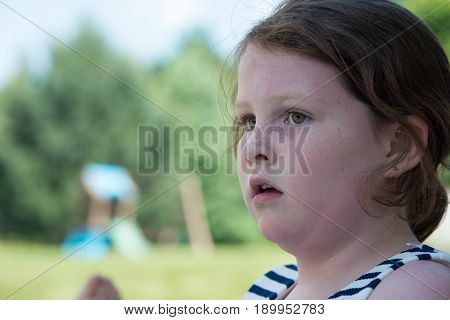 Close-up Portrait of Young Girl Looking Concerned Outside