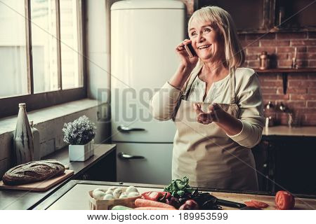 Old Woman In Kitchen