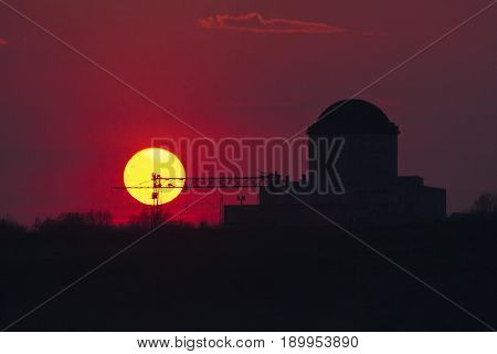 Crimson sunset Voronezh. Silhouette of nuclear power plant