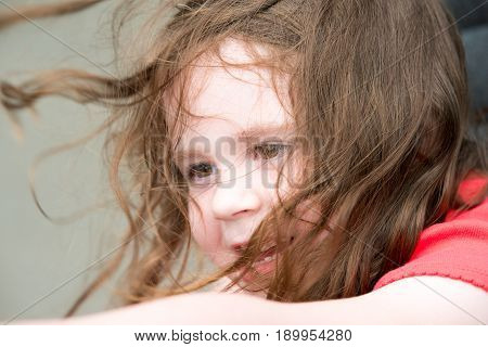 Happy Young Girl on Amusement Ride with Hair Blowing in the Wind