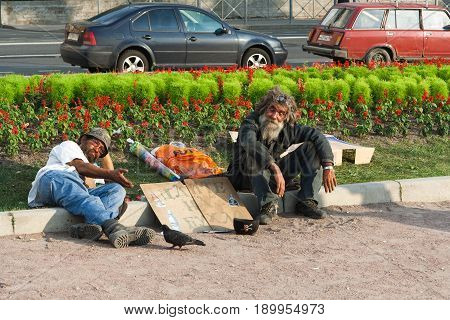 Saint Petersburg, Russia - JUNE 23, 2014: Sloppy homeless beggars begging