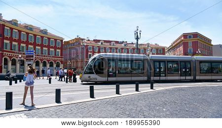 NICE, FRANCE - JUNE 4, 2017: A tram passing through the Place Massena square in Nice, France. The Place Massena is the main public square in the famous city of the French Riviera