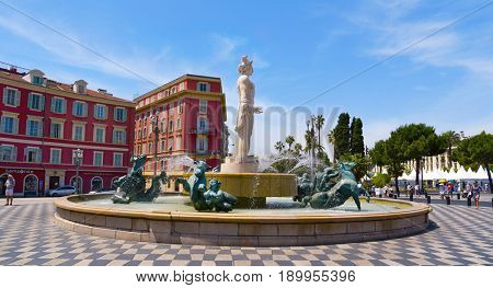 NICE, FRANCE - JUNE 4, 2017: A view of the fountain Fontaine du Soleil at the Place Massena square in Nice, France. The Place Massena is the main public square in the famous city of the French Riviera