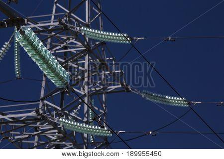 High voltage transmission power tower. Blue sky