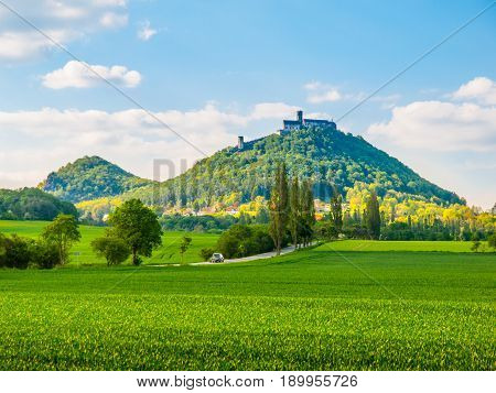 Medieval castle Bezdez on the mountain top. Sunny summer day with lush green fields in Czech landscape. Czech Republic.