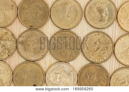 Gold coins on a wood desk background