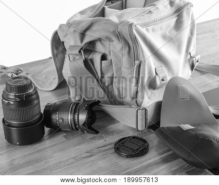 Camera bag and lenses in black and white