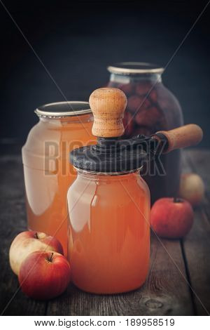 Glass Jar Of Juice, Apples And Retro Can Lid Closing Machine For Canning.