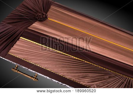 closed brown coffin covered with elegant cloth isolated on gray background. coffin close-up on royal background. Ritual objects for burial. Surrender body dust of the earth. Christian funeral ritual