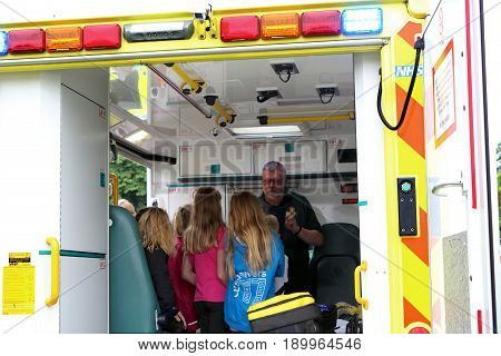 Beaulieu, Hampshire, Uk - May 29 2017: Paramedic In An Ambulance Addressing Visitors To The 2017 999