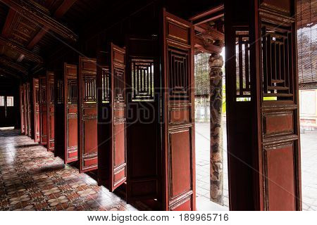 Old chinese asian wooden doors at temple.