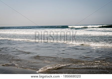 Pacific Ocean wave and beach in California, USA near San Diego
