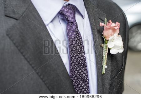 Pink rose boutonniere flower groom wedding coat with tie and shirt