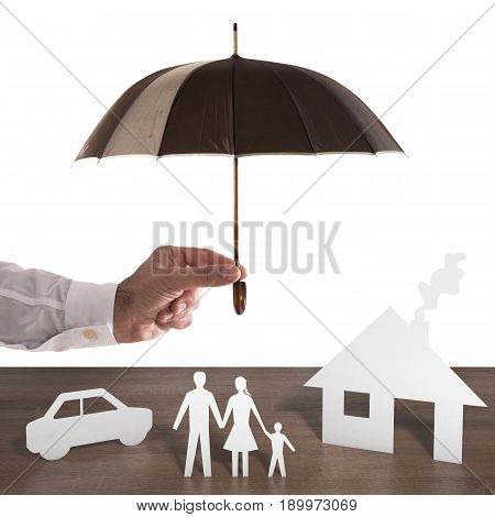 Paper family covered by an umbrella. Protect your family concept