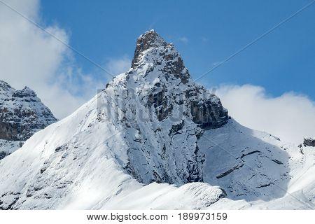 A solitary snow-covered mountain peak in Jasper National Park Alberta Canada.
