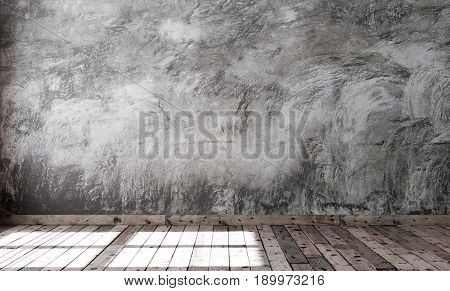 An empty minimalist style room with gray cement plaster on the wall and brown wooden flooring on the floor. Rough concrete walls and boards with dark knots. 3D rendering.