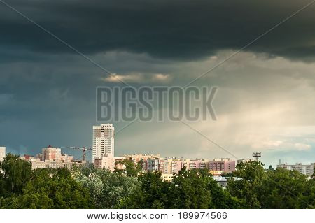 Cityscape With Gloomy Sky, Rays Of Sun And Rain.