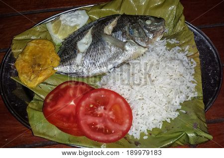 Special prepared fish wrapped in banana leaves at the amazonic jungle tour Ecuador