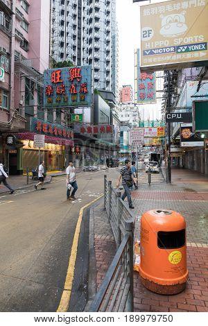 KOWLOON HONG KONG - APRIL 21 2017: Few Pedestrians at Mong Kok Morning in Kowloon Hong Kong.