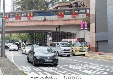 KOWLOON HONG KONG - APRIL 21 2017: Morning Traffic at Prince Edward Road in Kowloon Hong Kong.