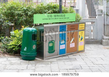 KOWLOON HONG KONG - APRIL 21 2017: Recycling Bin and Sorting Trash at Market in Kowloon Hong Kong.