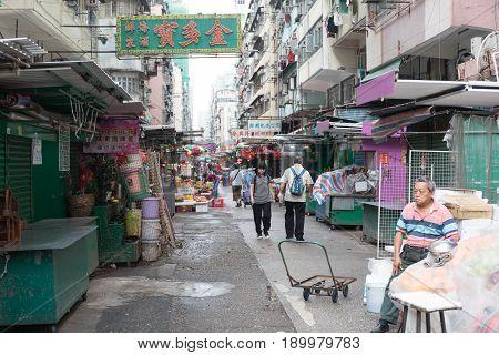 KOWLOON HONG KONG - APRIL 21 2017: Early Morning at Street Market in Kowloon Hong Kong.