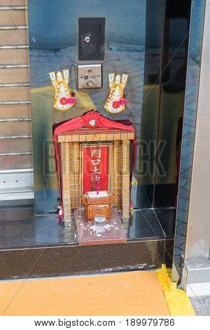 KOWLOON HONG KONG - APRIL 21 2017: Small Lucky Shrine in Front of Shop Mong Kok in Kowloon Hong Kong.