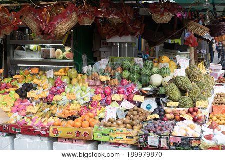 KOWLOON HONG KONG - APRIL 21 2017: Fresh Fruits and Vegetables at Street Market in Kowloon Hong Kong.