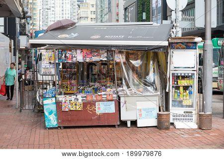 KOWLOON HONG KONG - APRIL 21 2017: Newspapers and Magazines at Newsstand Agent in Kowloon Hong Kong.
