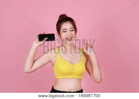 Asian Woman Sport Workout And Exercise Concept. Slim Body Girl Relax With Earphone Workout. Beauty F