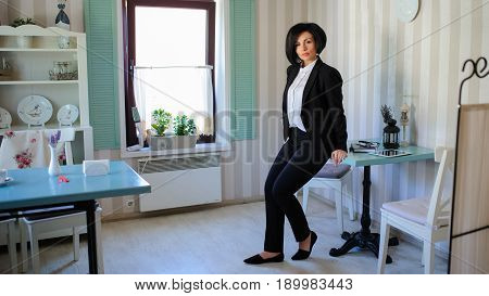 Beautiful  Business Lady Sitting In A Vintage Cafe/office